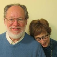 Ralph and Leslie Hergert in their home in Somerville. (Dan Mauzy/WBUR)