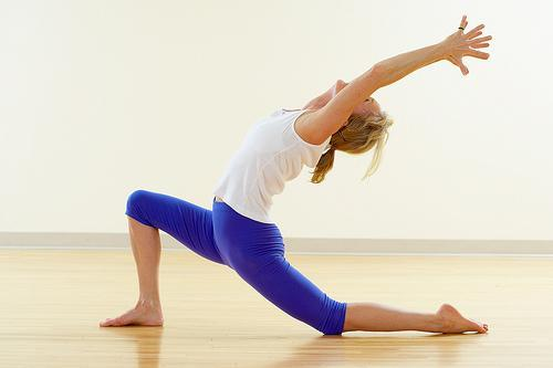Yoga, as well as intense, regular stretching eases back pain, researchers report