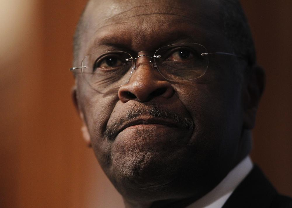 At the National Press Club in Washington, Republican presidential candidate, Herman Cain answered questions about sexual harassment allegations from the 1990s. (AP)