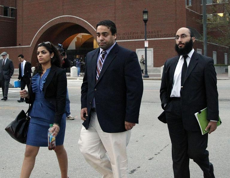 Tamer Mehanna, center, walks with two unidentified supporters from U.S. District Court in Boston, Oct. 24, after a day of jury selection in the trial of his brother, Tarek Mehanna. (AP)