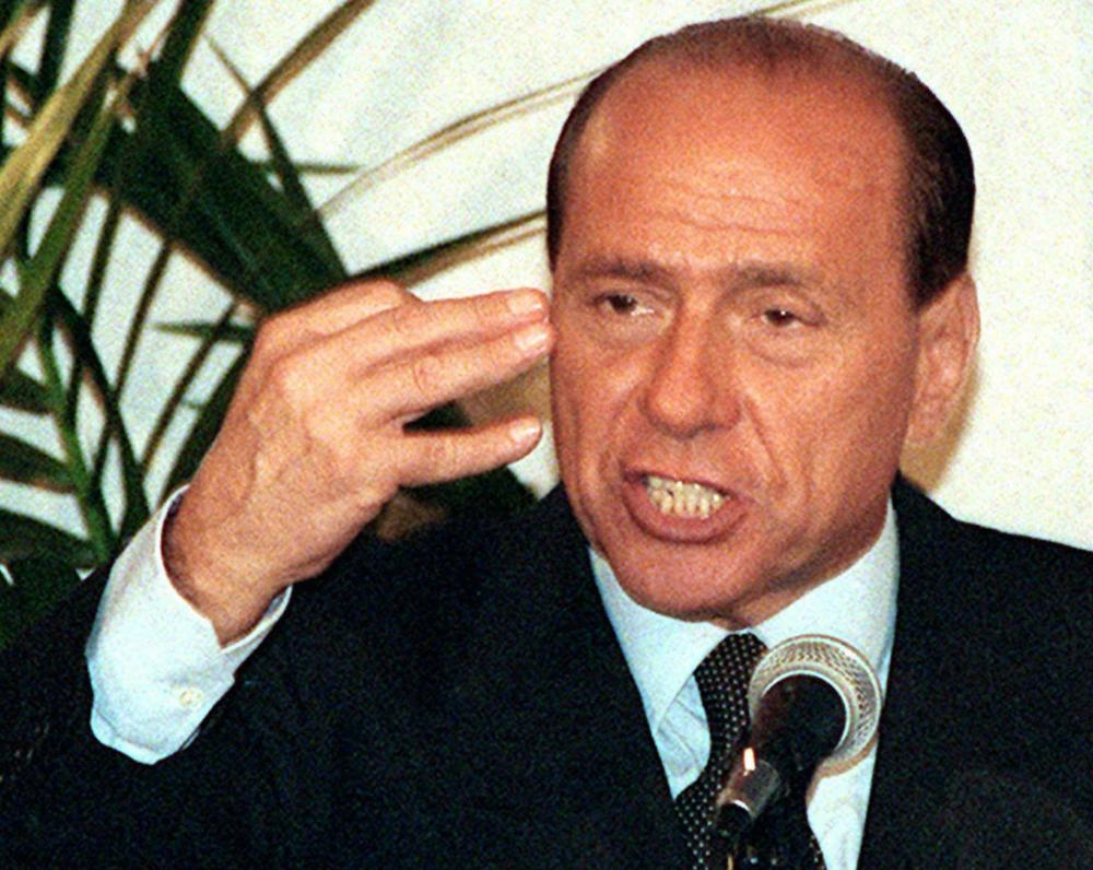 Italian Prime Minister Silvio Berlusconi, speaking at a party rally, is facing increasing pressure to step down in the wake of the European financial crisis.  (AP)