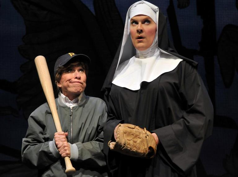 "A young boy (Ellen Colton, left) turns to the Mother Superior (Jeffery Roberson aka Varla Jean Merman, right) for help with his baseball skills in a scene from the SpeakEasy Stage Company production of ""The Divine Sister,"" running now thru Nov. 19. (Courtesy of Craig Bailey/Perspective Photo)"