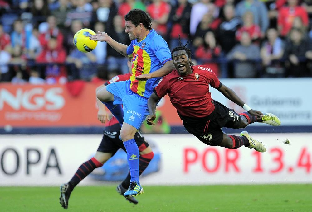 Levante's Asier Del Horno duels for the ball with Osasuna's Ibrahima Balde during their Spanish La Liga soccer match in Pamplona on Sunday. Levante lost the match 2-0. (AP)