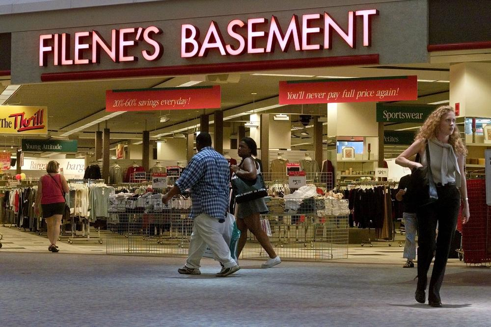 Passersby come and go from a Filene's Basement discount clothing store in a mall in Watertown, Mass. After over a hundred years in business, Filene's has filed for bankruptcy. (AP)