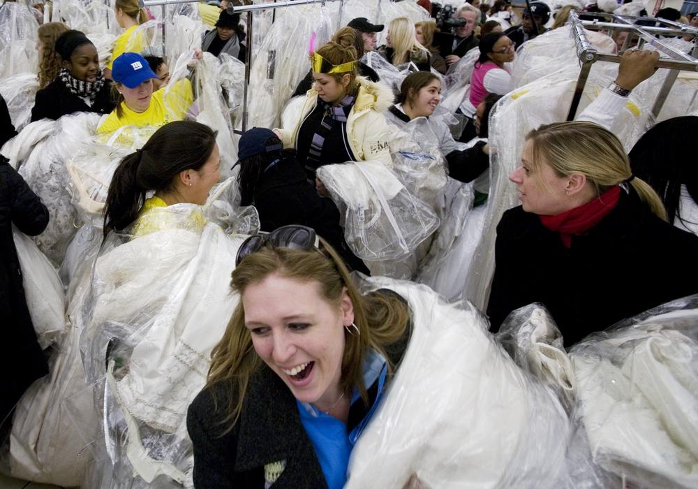 """Brides-to-be in a frenzy during 2008's """"Running of the Brides"""" at Filene's. A annual event where brides saved hundreds on designer wedding gowns. (AP)"""