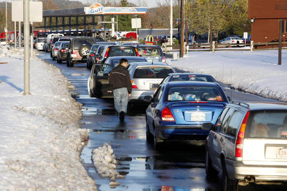 Motorists wait in line for gas at a rest area on the Massachusetts Turnpike eastbound in Charlton, Mass., Sunday. (AP)