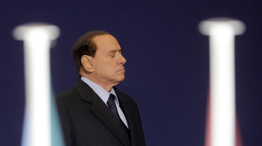Italian Prime Minister Silvio Berlusconi leaves after a meeting at the G20 summit in Cannes, France on Thursday. (AP)