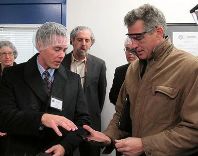 Sen. Scott Brown receives a tour of New Bedford's North East Silicon Technologies from President Rob Weeks, left. (Nick Fountain for WBUR)