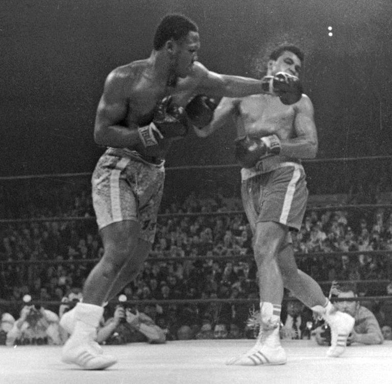 In this March 8, 1971, file photo, Muhammad Ali, right, takes a left from Joe Frazier during the 15th round of their heavyweight title bout in New York. Frazier won a unanimous decision. Frazier, the former heavyweight champion who handed Ali his first defeat yet had to live forever in his shadow, died Monday after a brief fight with liver cancer. He was 67. (AP)