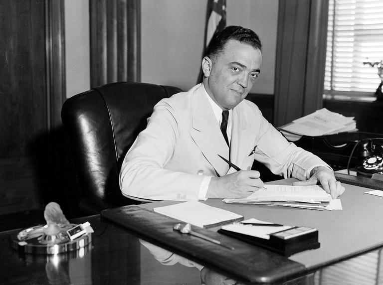 F.B.I. director J. Edgar Hoover is seen in his Washington office, date unknown. (AP)