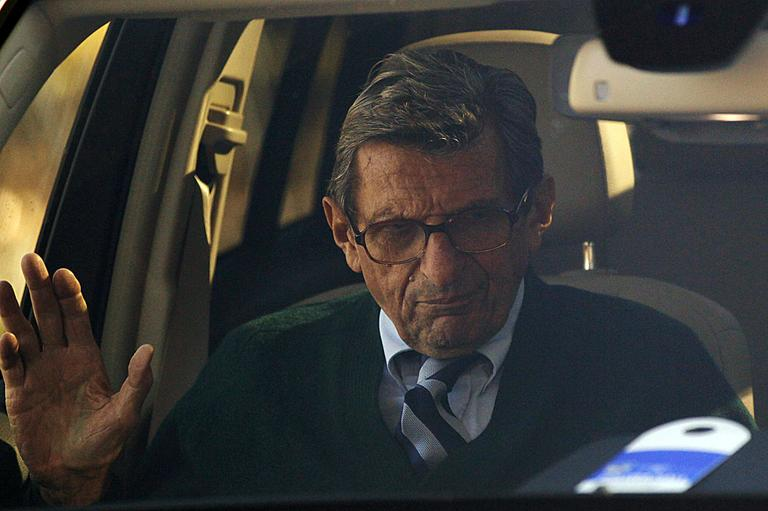 Penn State football coach Joe Paterno arrives home Wednesday, after announcing his plans to retire at the end of the college football season. (AP Photo/Matt Rourke)