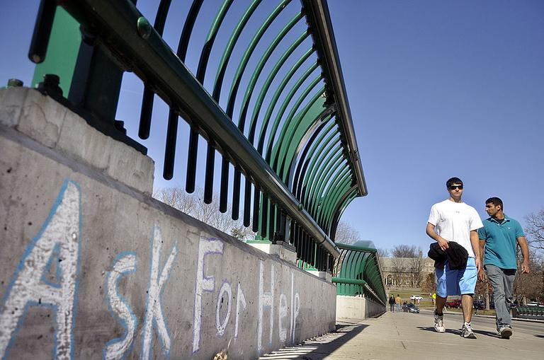 Cornell University students cross the college's Thurston Avenue Bridge in Ithaca, N.Y. in 2010, a year that saw three students there fall from campus bridges. (AP Photo/Heather Ainsworth)