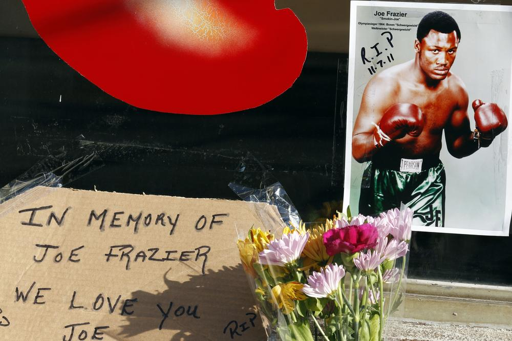 A tribute to Joe Frazier arranged outside the former location of his gym in Philadelphia. Frazier died Monday night after a brief battle with liver cancer at age 67. (AP)