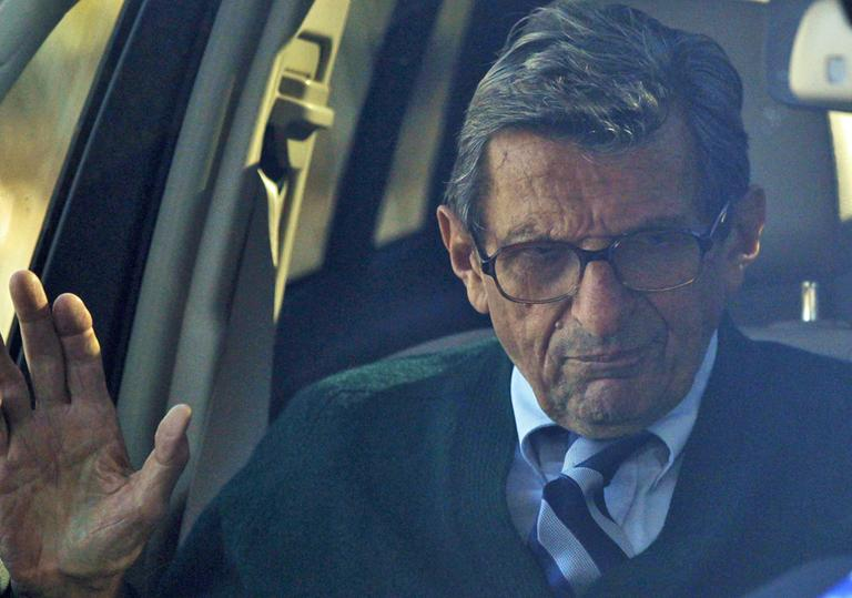 Penn State football coach Joe Paterno arrives home Wednesday, Nov. 9, 2011, in State College, Pa. Paterno has decided to retire at the end of the season, his long career brought down by his failure to do more about an allegation of child sex abuse against a former assistant.  (AP)