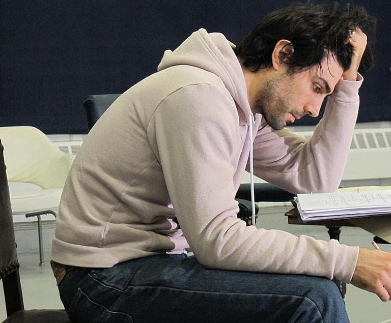 One of the actors in 'Captors' studies his script during rehearsal (Andrea Shea/WBUR)