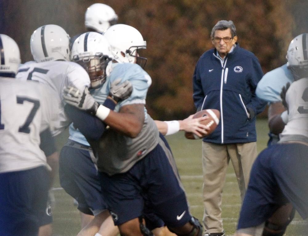 Joe Paterno watches Penn State football practice on Wednesday, his last day as head coach before he was fired by the Penn State Board of Trustees over a child sex abuse scandal. (AP)
