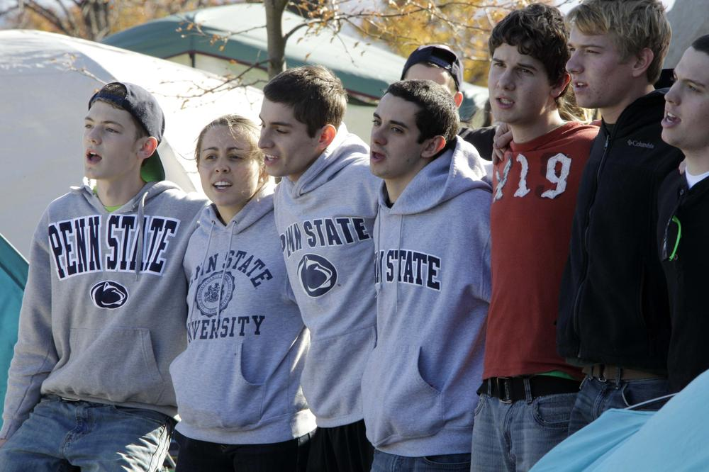 Penn State students show their support for the Nittany Lions outside Beaver Stadium in State College, Pa. on Wednesday after a sex-abuse scandal rocked the campus this week. (AP)