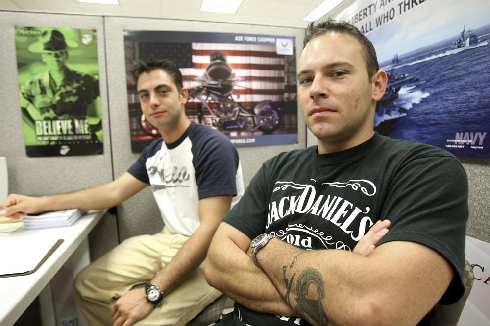 Derek Hollcraft, left, and Brandon Thomas, veterans of the current wars, discuss problems they and other veterans have encountered as they reenter civilian life at the office for student veterans at Broward Community College in Coconut Creek, Fla. (AP)