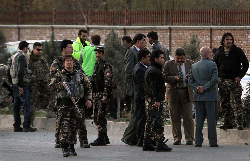Afghan security officials and forces are seen at the scene where an alleged suicide bomber was shot to dead in Kabul, Afghanistan on Monday. (AP)