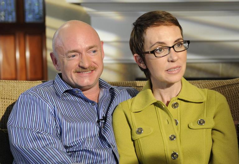 In this undated photo provided by ABC, U.S. Rep. Gabrielle Giffords and husband Mark Kelly are interviewed by Diane Sawyer on ABC's 20/20. (AP)