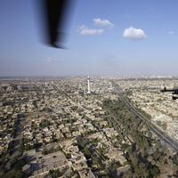A U.S. Army Black Hawk helicopter flies over the city of Baghdad, Iraq. (AP)