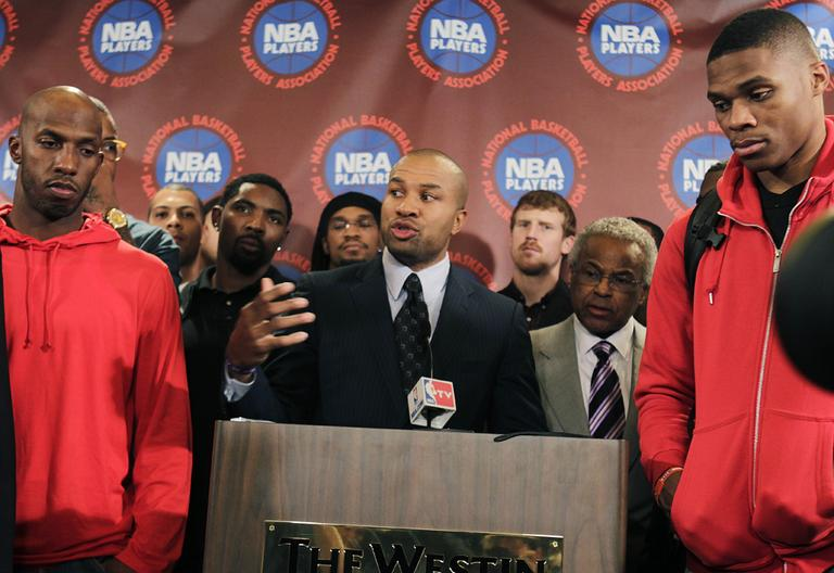 Surrounded by NBA players, including New York Knicks' Chauncy Billups, left, and Oklahoma City Thunder's Russell Westbrook, right, NBA Players Association president Derek Fisher speaks during a news conference after a meeting of the players' union in New York, Monday, Nov. 14, 2011. The NBA players rejected the league's latest offer and have begun the process to disband the union. (AP)