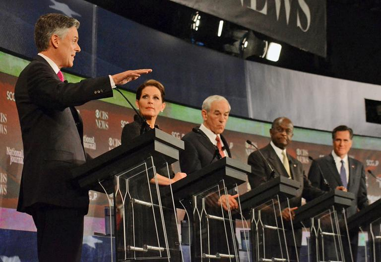 Republican presidential candidates from left, Jon Huntsman,  speaks as Michele Bachmann,  Ron Paul, Herman Cain, and Mitt Romney,  listen during the CBS News/National Journal foreign policy debate at the Benjamin Johnson Arena, Saturday, Nov. 12, 2011 in Spartanburg, S.C. (AP)