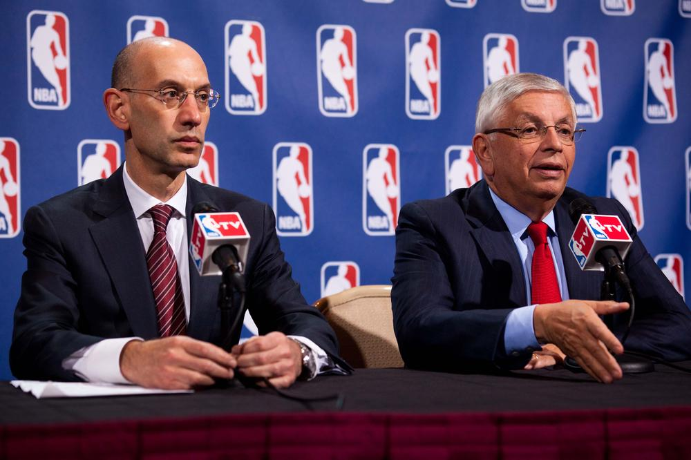 NBA commissioner David Stern (r) with deputy commissioner Adam Silver during a news conference after a marathon meeting with the Players Association on Thursday. (AP)