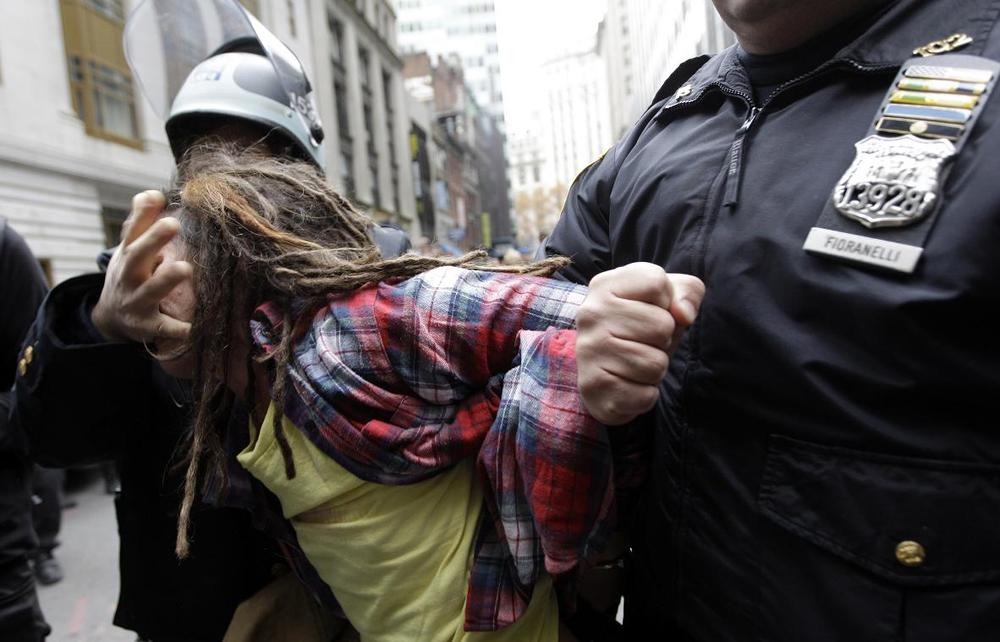 Police officers arrest a demonstrator affiliated with the Occupy Wall Street movement on Thursday. (AP)