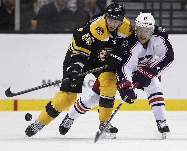 Boston Bruins center David Krejci, left, and Columbus Blue Jackets center Mark Letestu chase the puck during the second period of an NHL hockey game in Boston, Thursday. (AP)