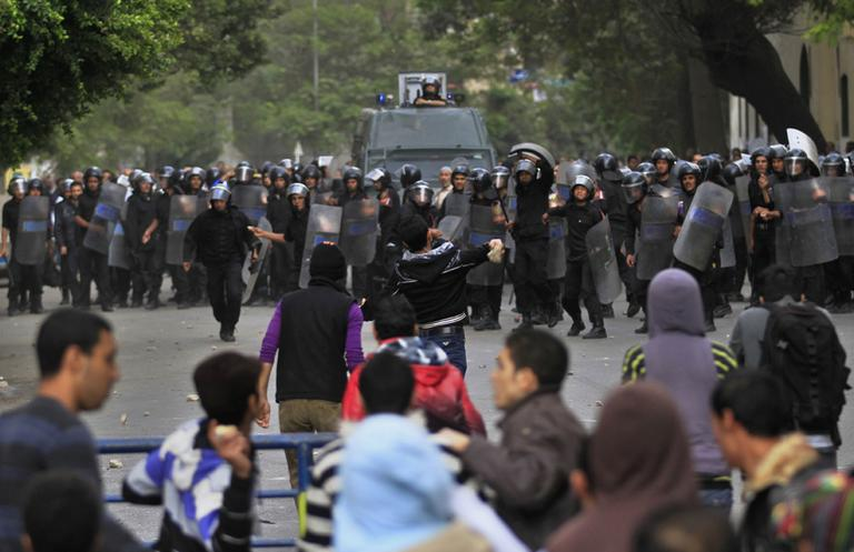 Protesters throw stones at Egyptian riot police during clashes in Tahrir Square in Cairo, Egypt, Saturday. (AP)