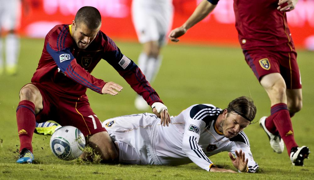 L.A. Galaxy midfielder David Beckham is fouled by Javier Morales of Real Salt Lake during the MLS Western Conference final on Sunday. L.A. will play Houston in the championship. (AP)