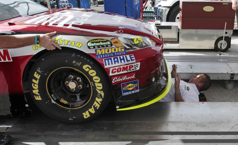 Driver Jeff Gordon's car gets a check-up before Sunday's NASCAR Ford 400 at Homestead-Miami Speedway. (AP)