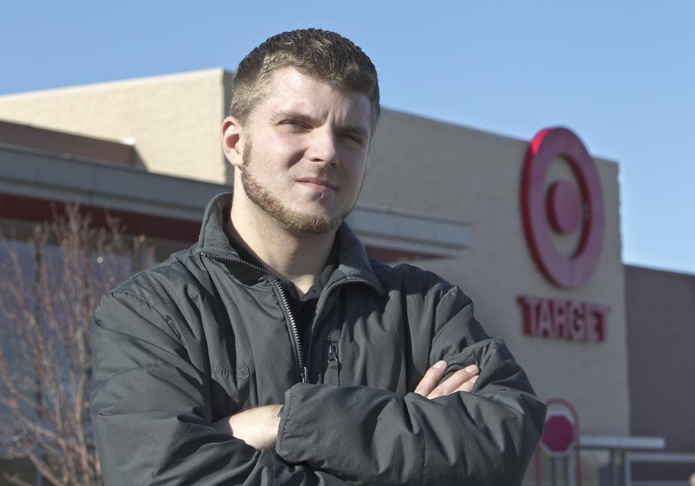 Anthony Hardwick, a part-time employee at a north Omaha Target store, poses for a photo in front of his place of employment. (AP)