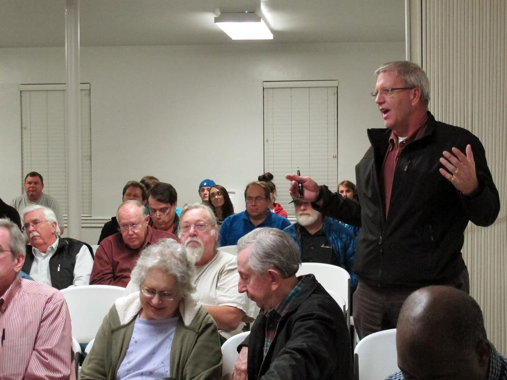 A member of the Mid-South Tea Party asks a question during a meeting where two Occupy Memphis members were speaking, Thursday in Bartlett, Tenn. (AP)