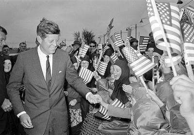 U.S. President John F. Kennedy is greeted as he arrives from Dublin by helicopter at Galway's sports ground, Ireland, June 29, 1963. (AP)