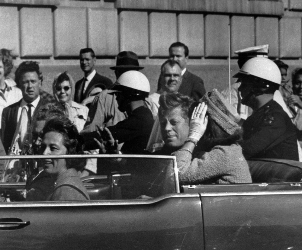 President John F. Kennedy is seen riding in motorcade approximately one minute before he was shot in Dallas, Tx., on Nov. 22, 1963. (AP)