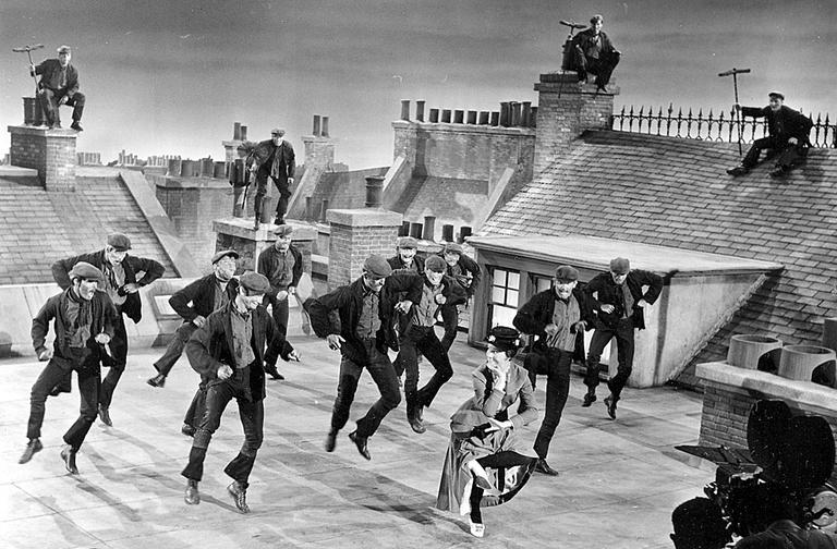 """Julie Andrews dances with the chimney sweeps during filming of """"Mary Poppins"""" in 1963. The Regent Theatre's Poppin's sing-a-long invites the audience to dress up as their favorite characters from the film. (AP Photo)"""