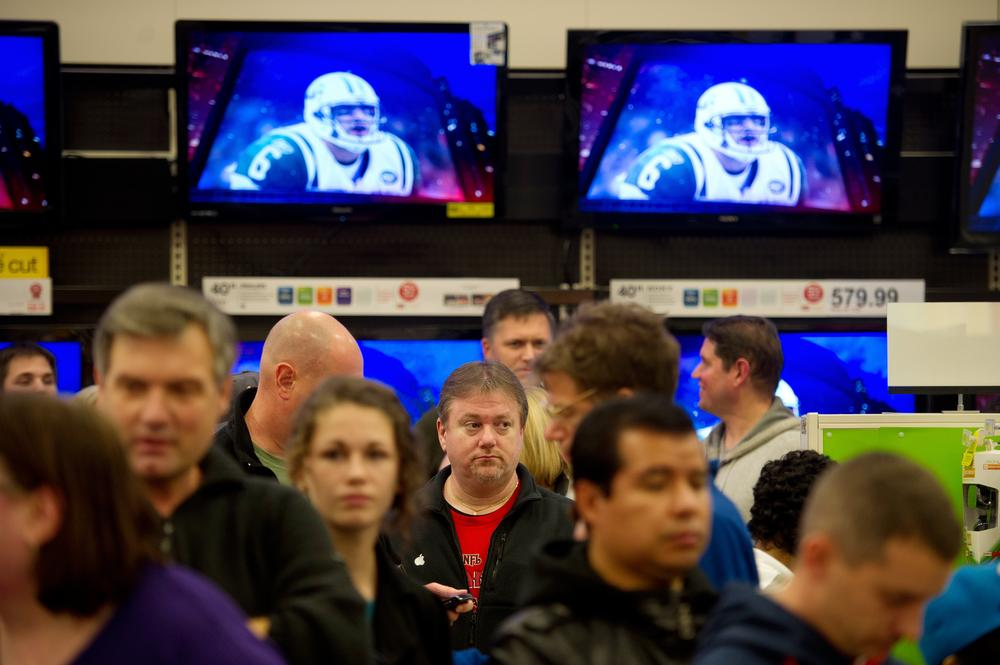 Shoppers wait in line to purchase electronic items on sale a Target store in Roswell, Ga., Friday Nov. 25, 2011.  (AP)