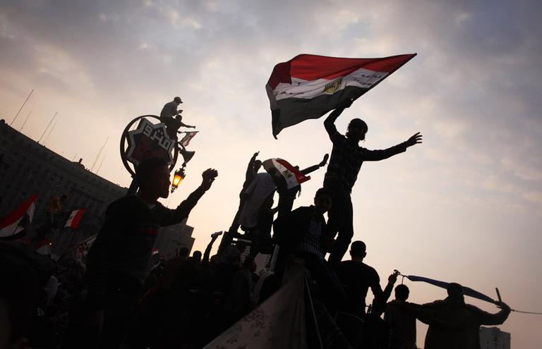 Egyptian protesters wave their national flags during a demonstration against the military council in Tahrir Square in Cairo, Egypt, Friday, Nov. 25. (AP)