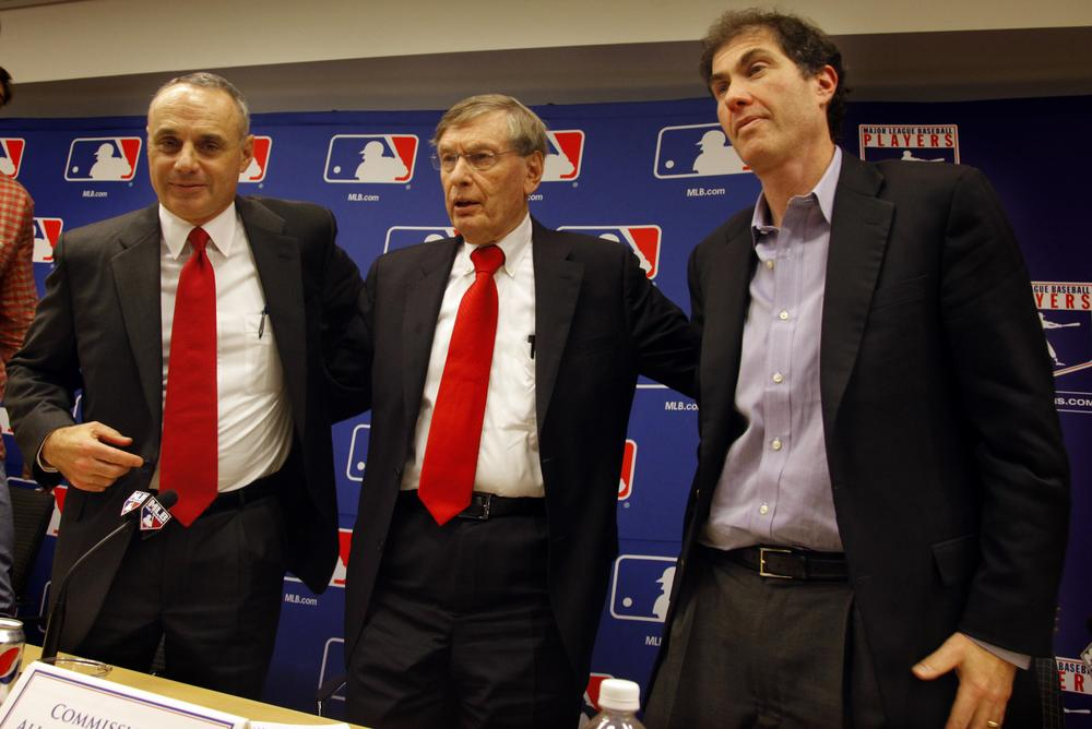 Major League Baseball commissioner bud Selig is flanked by VP of Labor Relations Rob Manfred and Players Association Executive Director Michael Weiner after announcing a new five-year collective bargaining agreement.  (AP)