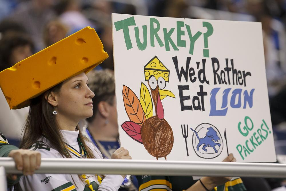 A Green Bay Packers fan pokes fun at the Detroit Lions during Thursday's traditional Thanksgiving day game in Detroit.  (AP)