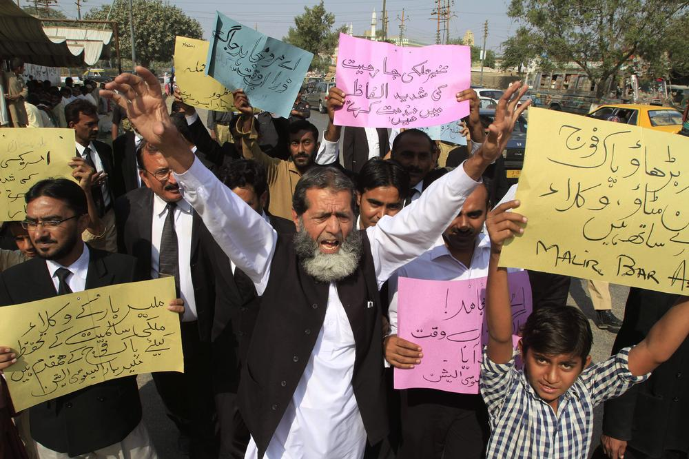 "Pakistani lawyers rally to condemn NATO strikes on Pakistani troops, in Karachi, Pakistan, on Monday. Placard on right reads "" Go ahead Pakistan army we are with you.""(AP)"