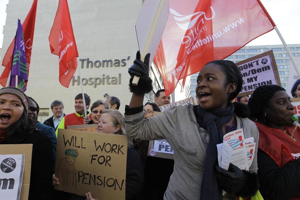 Health workers demonstrate during a strike over pensions, outside St. Thomas' Hospital, London, Wednesday. (AP)