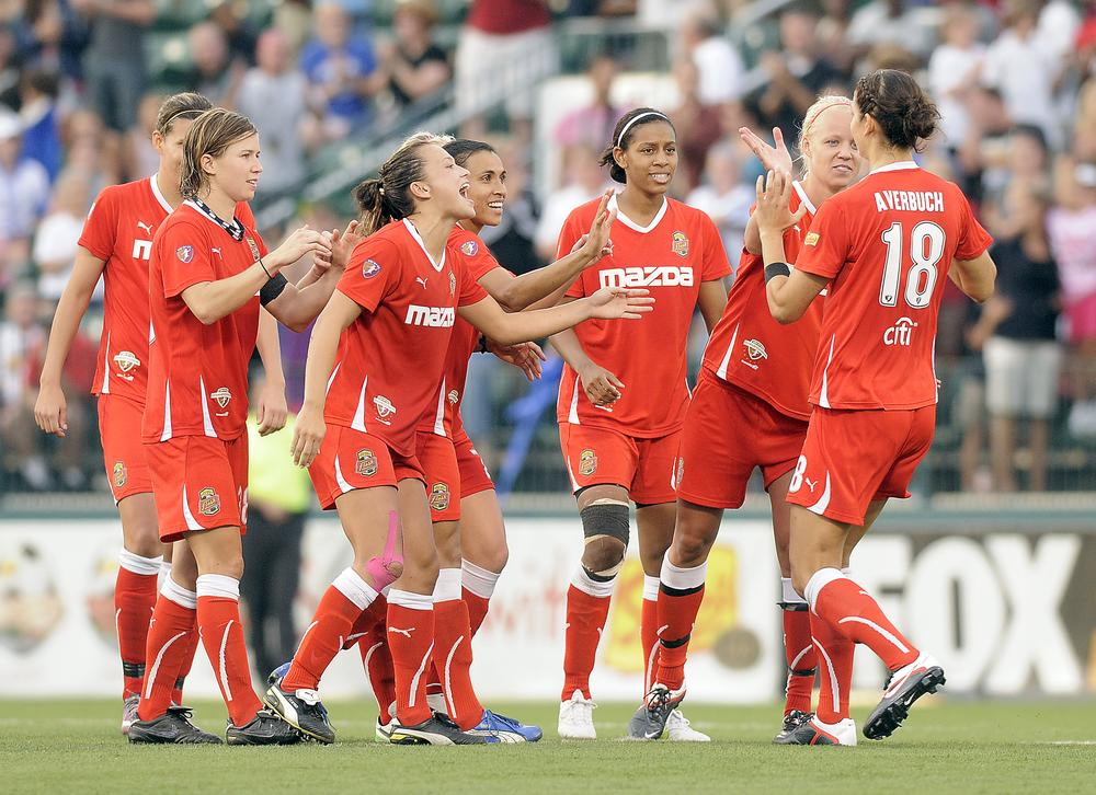 Western New York Flash players congratulate Yael Averbuch for her winning goal in August's championship game. With the league's future in doubt, it could be the last WPS title match. (AP)