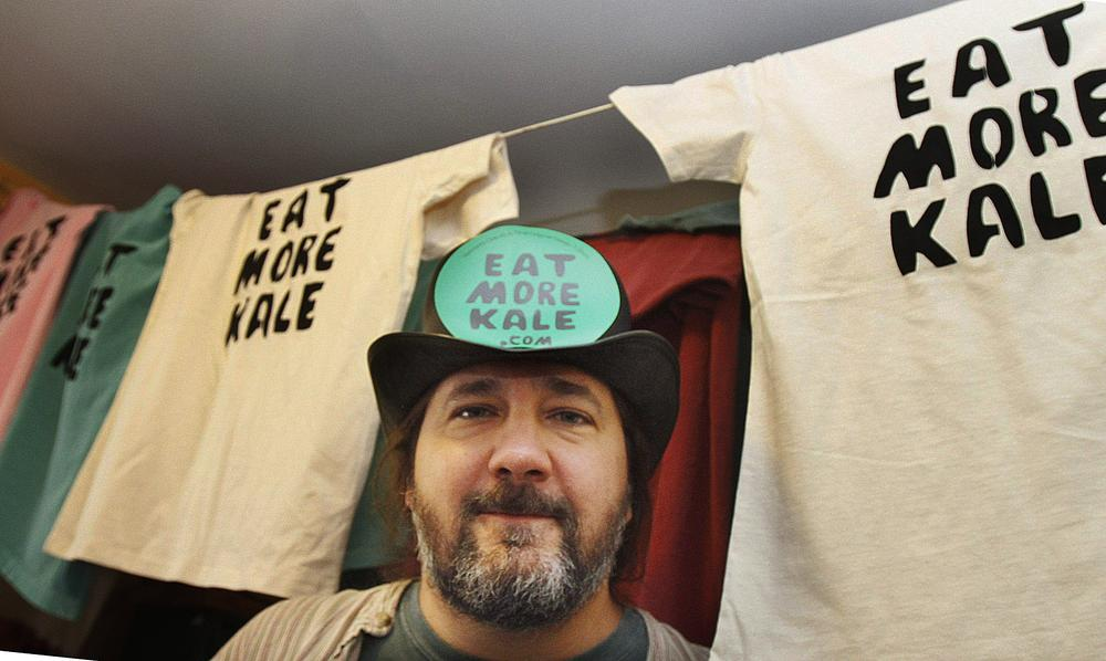 "Bo Muller-Moore with his apparel that says ""Eat More Kale,""  is running into opposition from the second largest fried chicken retailer in the country, Chick-fil-A. (AP)"