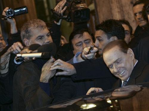 Italian Premier Silvio Berlusconi, right, enters his car at the end of a meeting with his allies in the Italian Senate in Rome, Thursday, Nov. 10, 2011. (AP)