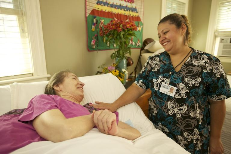 Hospice worker and Schwartz Center prizewinner Vilma Barrios with a patient