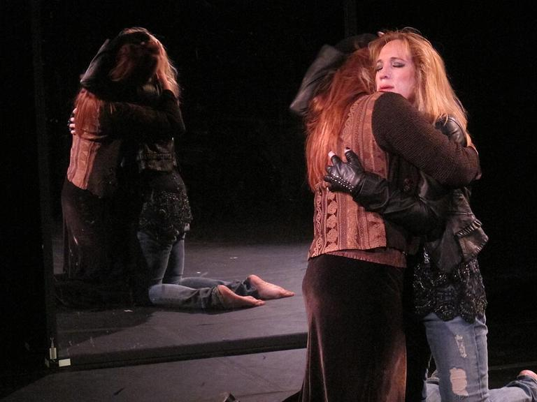 The Oedipus complex is at work in this scene, where a lesbian Hamlet embraces Ophelia. (Andrea Shea/WBUR)