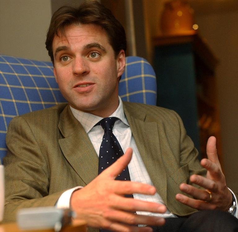 "Historian and author Niall Ferguson talks about his new book, ""Empire,"" during an intetrview in Cambridge, Mass., April 11, 2003. ""Empire,"" a follow-up to a television series that drew 2.5 million viewers in Great Britain, is a spirited defense of Britain's record as an imperial power. (AP)"